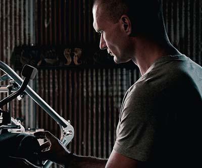 huntington beach auto repair - man working on auto motor